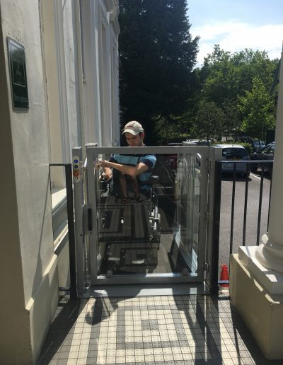 Image - Christian in wheelchair using platform lift independently