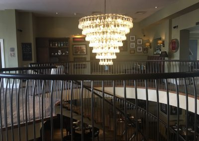 Image - decor in bar and stair leading down to bistro