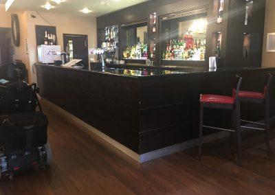 Image description - Bar in Merlot Suite, tall L-shaped bar