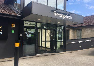 Image description - Large double electric doors to reception