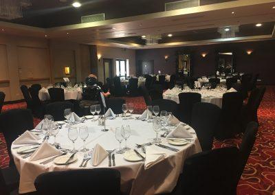 Image description - Merlot suite, large circular tables set up for conference